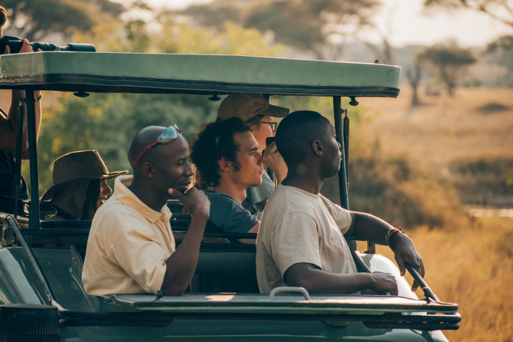 Guides, Driver and contiki travelers on safari