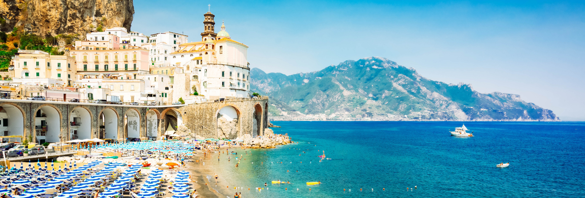 view of the Amalfi Coast umbrella lined beaches and bright blue water